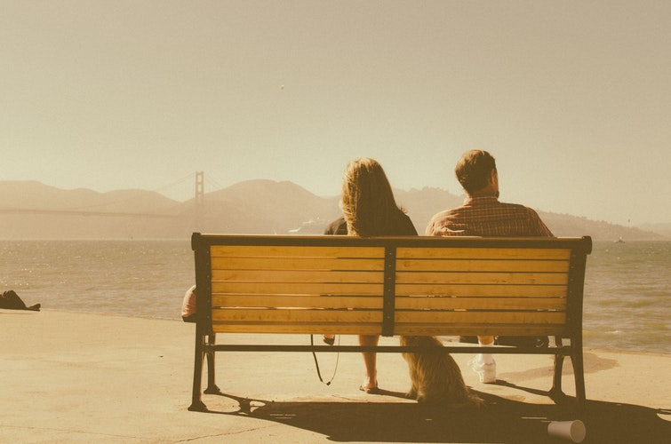 Does my partner care about me - a couple sitting on the bench